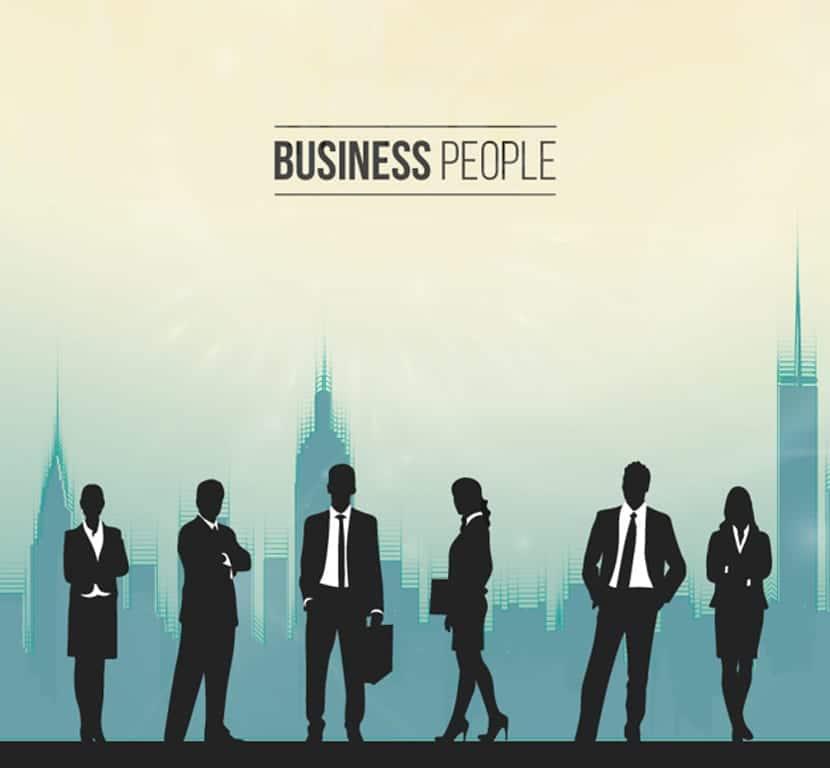 Siluetas de personas en una oficina ocupada