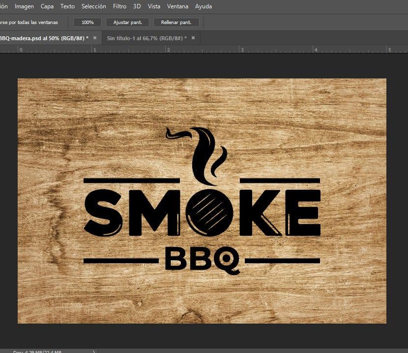 Photoshop logo negro en fondo de madera